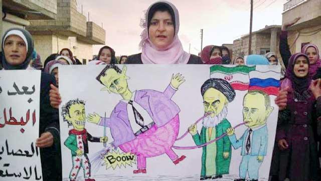مردم بی دفاع سوریه که از دست بشار اسد و خامنه ای شریک هم جنایتکار او به تنگ آمده اند، در یک کاریکاتوری نشان می دهند که چگونه اسد به وسیله پوتین و خامنه ای باد شده و در هوا می چرخد!.