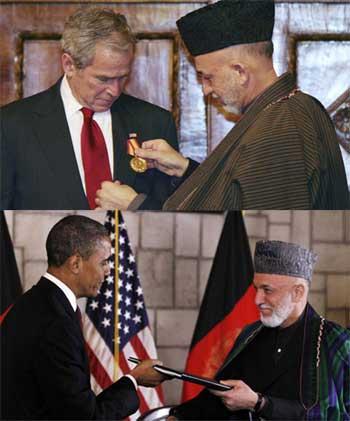 حامد کرزای نماینده و دست نشانده آمریکا در افغانستان برای سمت و پست خود نشان قدردانی و سپاسگزاری به رهبران آمریکا پیشکش می کند.