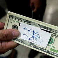price-of-iranian-rial-crashes-us-dollar-tehran-iran-2012-protests
