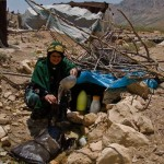 an-old-woman-in-iran-pours-water-at-a-stream-poverty