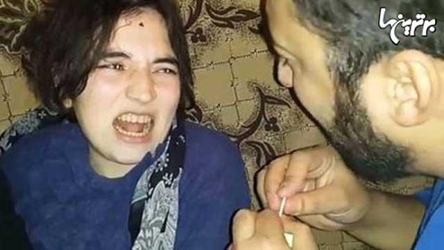 (در ویدئو ادعا شده است که این دختر جن زده است! اولا تعریف حن زدگی چیست؟ و چه کسی کشف کرده است که ابزار رفع آن قرآن و کبریت است؟)