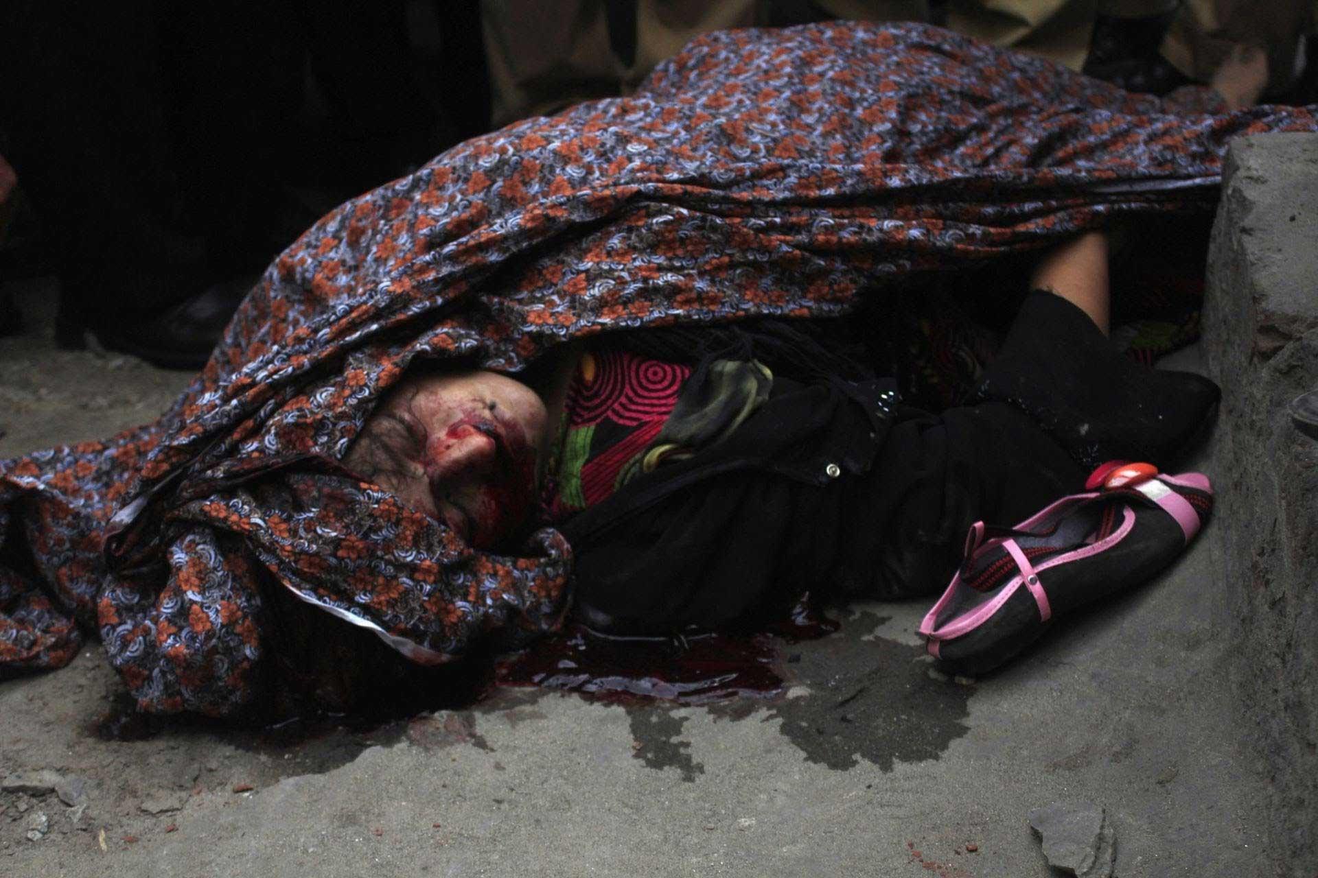 women-in-pakistan-pregnant-stoned-to-death-portrait