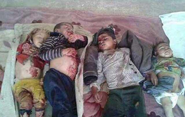 گروه داعش یکی از نمایندگان الله در عراق حتی از کشتار کودکان نیز پرهیزی ندارد. و به هیچ کس رحم نمی کند. اینها کودکان یک دهکده اند که به خواست الله کشته شدندن.