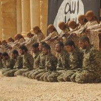 Harrowing footage: Child executions were forced to brutally slaughter a group of more than 25 regime soldiers in Palmyra